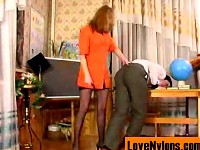 Bossy babe in full-fashioned nylons treating a guy like her humble servant