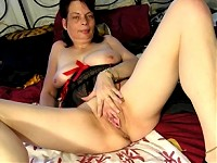 Kinky mama playing with herself