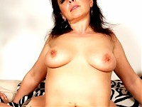 This horny mature slut loves a younger cock inside her