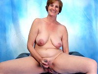 Curvaceous, with short red hair, large natural tits, and a thick ass, Anilos Ray Lynn is a granny that will keep your cock rocked! Watch as she stuffs her hairy mature pussy with all sorts of sex toys!