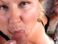 A horny blonde granny gets her old pussy fucked by two cocks