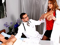 Alanah And Keiran are checking out their latest work, a breast implantation, on a patient.  Alanah doesn't think they've made the breasts big enough, where-as Keiran thinks they're perfect. To prove how much better they could be, she pulls out her bigger boobs and convinces him otherwise.