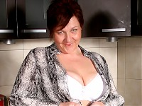 Big breasted mature slut playing in her kitchen