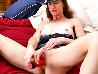 Sexy Anilos Milf Kimberly masturbating in bed with her red vibe reaches her orgasmic satisfactions.