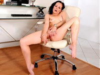 Beautiful Claudia Adkins shows us how she masturbates her Anilos pussy on a chair
