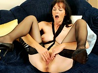 Horny cougar mom fingers her mature pussy then uses her..