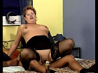 Plump sexy mature in nylon stockings having sex