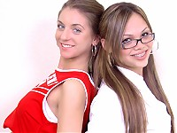 Naughty schoolgirl and cheerleader kiss and lick each other