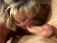 Older mom sucking a cock