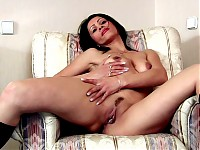 Exotic nymph Nelli is a cougar with dark elegant featur..