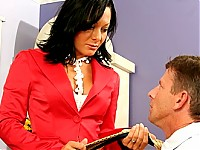 Sandra Romain looks so damn sexy in her bright red business suit but it isn't the clothing that makes her a MILF Boss worth lusting after -- it's those shiny red shoes! Even after she peels off her outfit and her underwear she lives those high heels on to