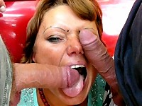 This broad sucks and swallows two cocks