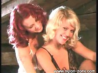 Two Curly Haired Models In Stockings And Garters Having Fun