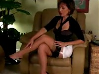 Hot Roni strokes her legs in nylon stockings