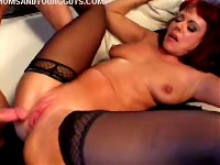 Hot milf in black stockings enjoys getting her pussy drilled by a hard young dong
