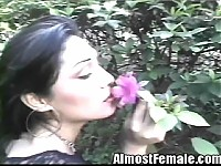 An Asian tranny walks around her garden and even stops ..
