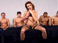 Five men gangbang a redhead in black lingerie