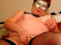 This masked mature slut loves to play