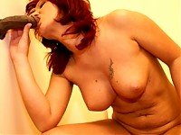 Hot red MILF using he gloryhole