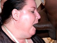 Chunky housewife sucking on a black cock