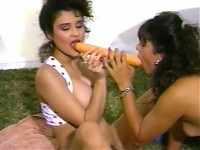 Two hot girls poke each others clit
