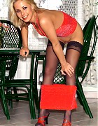 Hot blonde in black stockings and red heels Picture 1