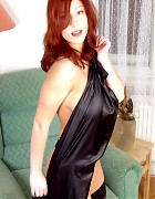 Hot redhead with big tits in black dress and stockings Picture 11