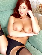 Hot redhead with big tits in black dress and stockings Picture 14