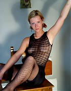 Hot Lindsey in black fishnet stockings Picture 1