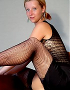 Hot Lindsey in black fishnet stockings Picture 12