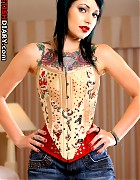 Tattooed beauty in a tattoo corset Picture 2