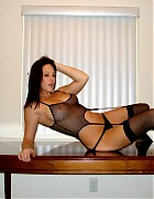 Hot Natalie teasing in black stockings Picture 13
