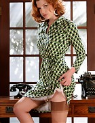 Redhead secretary in dress and holdup stockings Picture 2