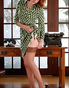 Redhead secretary in dress and holdup stockings Picture 3