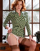 Redhead secretary in dress and holdup stockings Picture 5