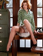 Redhead secretary in dress and holdup stockings Picture 6