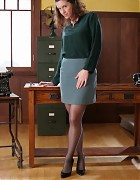 Brunette secretary with stockings an corsette Picture 1