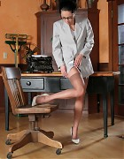 Asian secretary with stockings and white heels Picture 5
