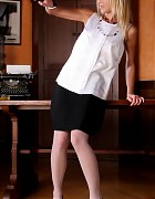 Blonde secretary in black skirt and white stockings Picture 1