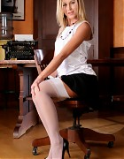 Blonde secretary in black skirt and white stockings Picture 3