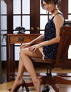 Cute Secretary in short dress and stockings Picture 5