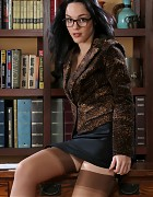 Innocent Librarian in skirt and stockings Picture 1