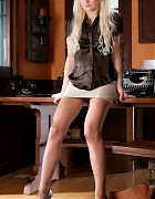 Blonde in way too short skirt and pantyhose Picture 1