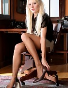 Blonde in way too short skirt and pantyhose Picture 5