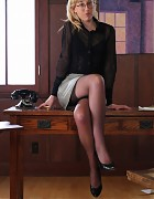 Blond secretary in grey skirt and nylon stockings Picture 2