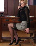 Blond secretary in grey skirt and nylon stockings Picture 4