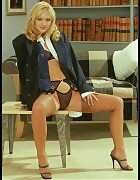 Sassy Business Boss In Power Suit And Tan Silk Stockings Picture 1