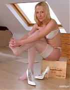 Crissy in white lingiere and stockings Picture 11