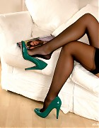 Black nylon stockings and sexy green high heels on this babe Picture 12