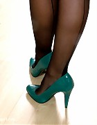 Black nylon stockings and sexy green high heels on this babe Picture 16